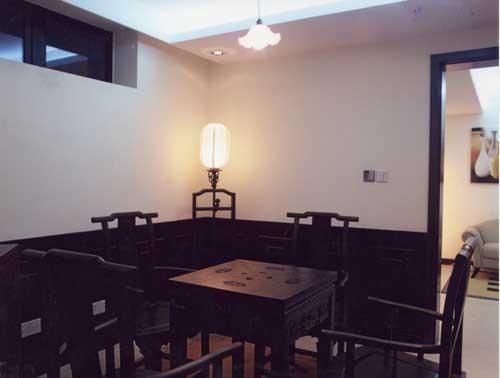 传统中式墙裙与复古砖的运用体现了麻将室的中式情调