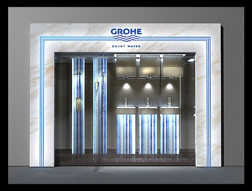 这个方案,设计师考虑得更多的是橱窗和高仪企业形象的结合,企图从橱窗的展示中透露出企业的高端品质,高端设计的形象。 设计大面积用了很中性的材质-黑色镜面淡化了除产品以外的空间。而产品则展示在蓝白色的流水形马赛克上,加上灯光的配合,就和黑色的环境形成了比较大的反差。